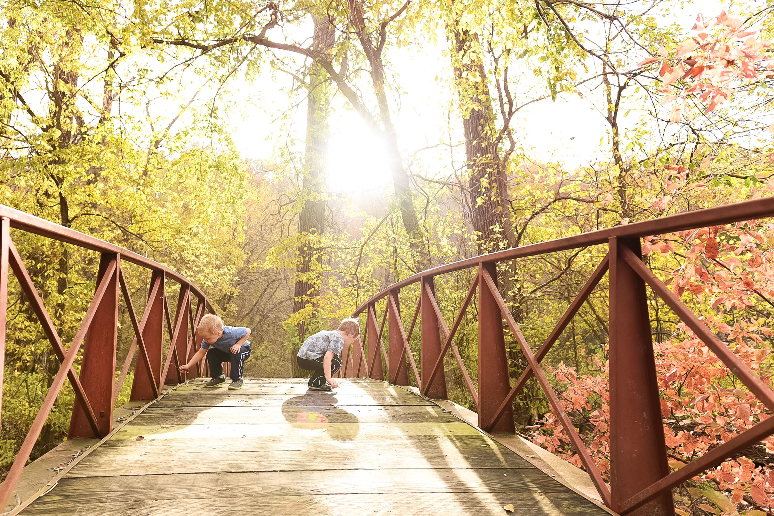 Image of 2 children playing on a bridge at Seven Mile Creek